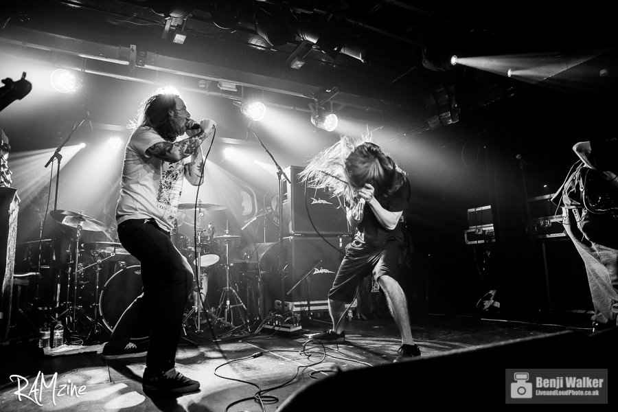 Liam of Cancer Bats on stage with Incite.